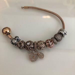 Pandora Jewelry - Rose gold pandora bracelet (charms included)
